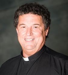 Vandenakker, Fr. John